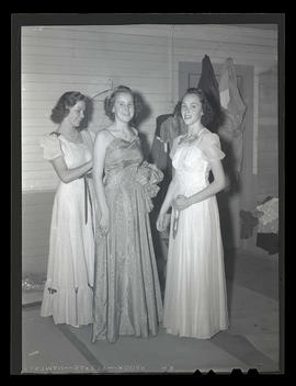 Three teenage girls in formal dresses