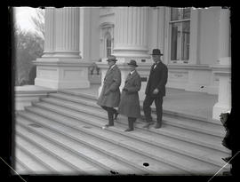 Three unidentified men walking down steps of Oregon State Capitol