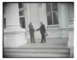 Governor Isaac L. Patterson and Walter M. Pierce shaking hands