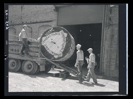 Men working with large spool of cable
