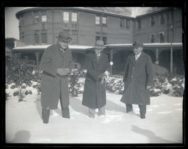 George L. Baker, Charles Wakefield Cadman, and Frank C. Riggs in snow at Union Station, Portland
