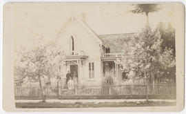 Three unidentified women on porch of house