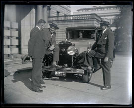 Mayor George L. Baker and unidentified men with car at Portland City Hall