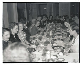 Unidentified women dining at event