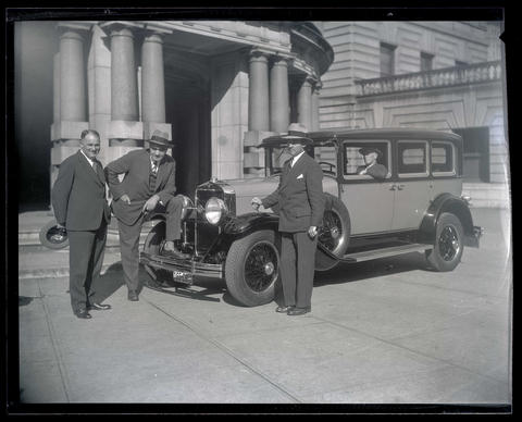 Mayor George L. Baker and unidentified men with car at Portland ...