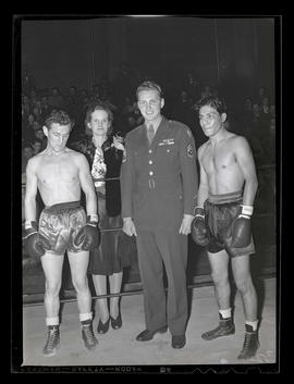 Melva Lillian Cole with serviceman and two boxers