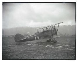 Two people, probably Tex Rankin and Ray Bartley, in biplane