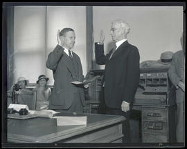 Judge Hall S. Lusk swearing in Milton A. Miller as collector of customs