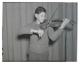 Boy holding violin and bow