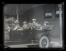 Unidentified people in car at Union Station, Portland