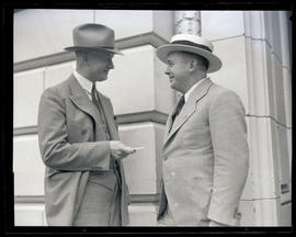Joseph K. Carson and unidentified man outside Oregon Journal building