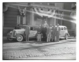 Elks ambassadors and group posing with tour cars in Portland