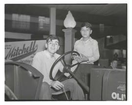 Unidentified boys with tractor?, probably at Pacific International Livestock Exposition