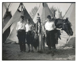 Rosalie Tashwick Kanine with horse and three unidentified boys at Pendleton Round-Up?