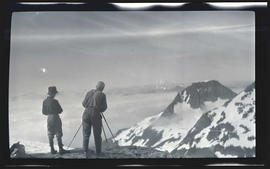 J. B. Flett and William Finley Jr. photographing Pyramid Peak