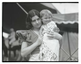 Circus performer with child