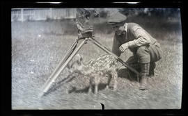 William Finley photographing a fawn