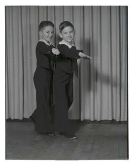 Two young tap dancers in costume