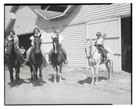 Four girls on horseback