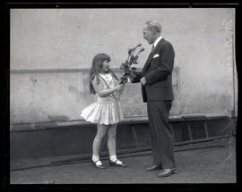 Unidentified girl handing roses to Brees