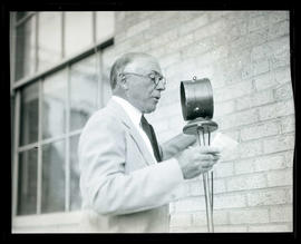Dr. Bilderback, speaking into microphone