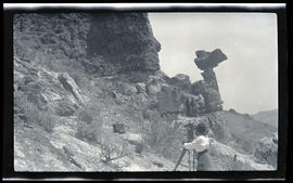 Irene Finley photographing a balancing rock