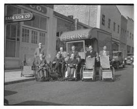 Group of men with wheelchairs, posing in street