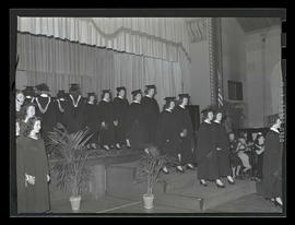Graduates walking off stage at 1943 Marylhurst College commencement