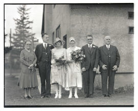 Unidentified wedding party and family members?, outside building