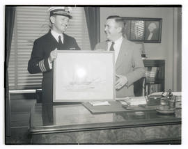 Commander Louis J. Gulliver presenting picture of USS Constitution to Mayor Joseph K. Carson