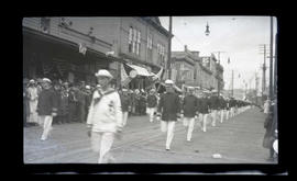 Uniformed men in parade, possibly in Astoria