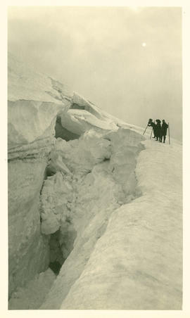 Three people at the head of the Collier Glacier on Middle sister. Elevation about 8000 feet
