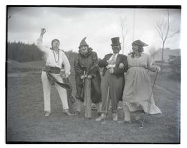Four golfers in costume