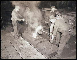 Pouring steel into a flask in the Columbia Steel Casting Company foundry