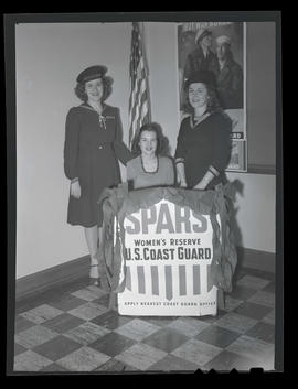 Marylhurst College students at booth with sign for Coast Guard Women's Reserve, 1944?