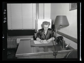 Unidentified woman sitting at desk