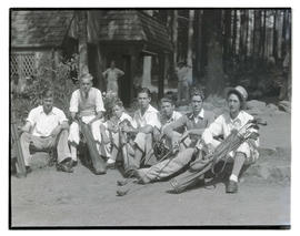 Seated golfers holding clubs