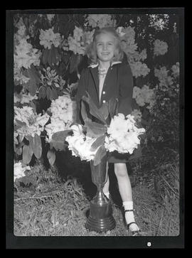 Unidentified girl posing with rhododendrons and Corbin Cup