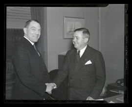 Portland Mayor Joseph K. Carson and unidentified man shaking hands