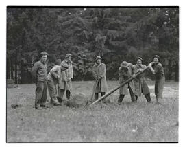 Civilian Conservation Corps workers? moving large rock