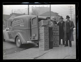 Four men with truck and boxes of beer at Columbia Beverage Company, Portland