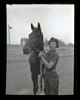 Woman and racehorse