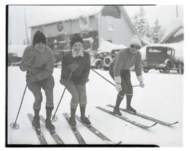Three skiers on road