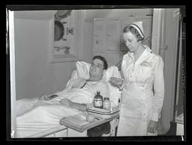 Nurse and patient aboard ship