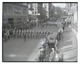 Uniformed men marching in parade
