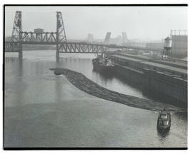 Timber raft on Willamette River near Steel Bridge, Portland