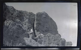 William Finley Jr. climbing on rocks
