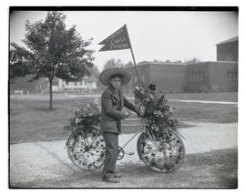 Boy with decorated bicycle