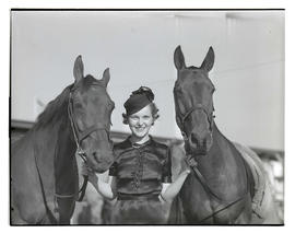 Woman with two horses
