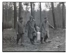 Civilian Conservation Corps workers? carrying milk can